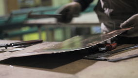 Working sheet metal is measured with a caliper. HD stock video
