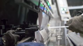 Working with sheet metal on special machine tools for bending. On industrial manufacture stock footage