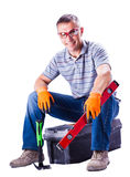 The working sitting on a box with tools Stock Photo