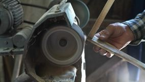 Working on small sanding machine. At home stock footage