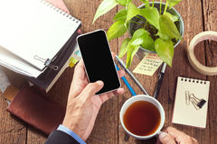 Working with smartphone Stock Image