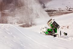 Working snow cannon at ski resort. Stock Photography