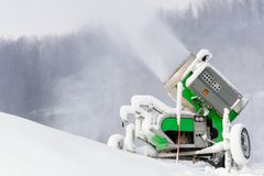 Working snow cannon at ski resort. Stock Image