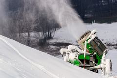 Working snow cannon at ski resort. Stock Photos