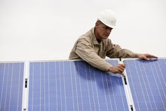 Working On Solar Panels Royalty Free Stock Image