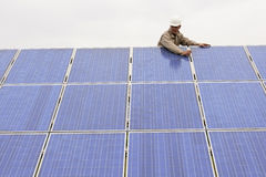 Working On Solar Panels. Technician Working On Solar Panels Royalty Free Stock Image