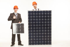 Working with solar panels smiling Royalty Free Stock Image