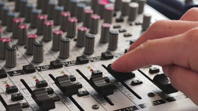 Working with Sound mixing console stock video footage