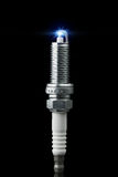 Working spark plug with blue sparkle Royalty Free Stock Image