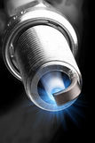 Working spark plug with blue sparkle Royalty Free Stock Photography