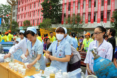 The working state of the medical staff. Half international marathon in fushui county in yunnan province in China, time: on September 25, 2013 Royalty Free Stock Images