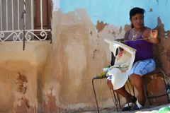 Working on the street, Trinidad, Cuba Royalty Free Stock Photo