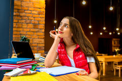 Working or studing in the cafe Royalty Free Stock Image