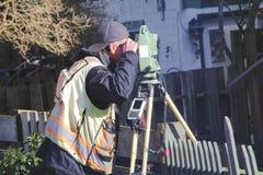 Working Surveyor and Transit stock images