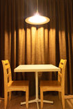 Working table and chairs with light lamp. Working table and chairs in hotel with light lamp Royalty Free Stock Photography
