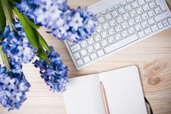Working table with flowers Stock Images