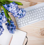 Working table with flowers Royalty Free Stock Photos