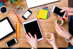 Working on table with gadgets. Working or studying with digital gadgets and different colorful stuff and coffee on the wooden table. Top view royalty free stock images