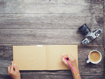 Working table with notebook paper Royalty Free Stock Photos