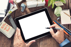 Working with tablet. Businessman working with tablet on wooden desktop Royalty Free Stock Photos
