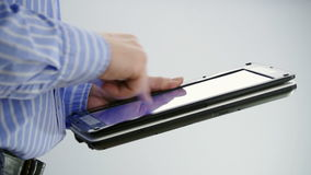 Working on tablet PC. Medium Shot of man working on tablet PC with touch screen stock video