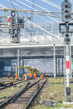 Working team doing maintenance service at railway. While red traffic lights are on Stock Photos