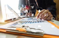 Working team meeting concept, businessman using smart phone and laptop and digital tablet computer stock photo