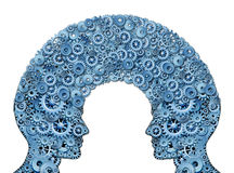 Working Team. And teamwork education symbol represented by two human heads shaped with a group of gears and cogs as a concept of intellectual communication Stock Photos