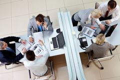 Working teams. View from above of two business teams working separated by border in office Royalty Free Stock Image