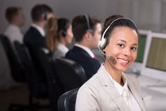 Working at telemarketing. Smiling women with headset working at telemarketing Stock Images