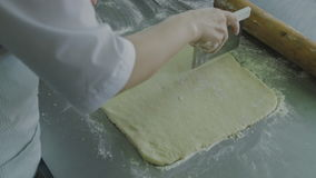 Working with test. Unrolling a rolling pin dough for cookies stock footage