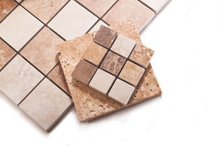 Before working tiler. Tiles, trowel, spatula, sandpaper on a white background Stock Images