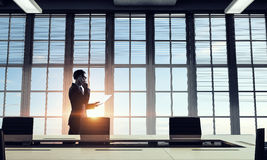 He is working till sundown. Mixed media . Mixed media Royalty Free Stock Photos