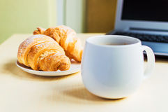 Working time, coffee break with croissant Stock Photo