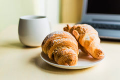 Working time, coffee break with croissant Stock Images