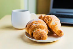 Working time, coffee break with croissant Stock Photography