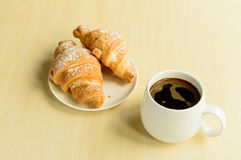 Working time, coffee break with some croissants.  Royalty Free Stock Images