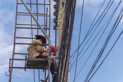 Working to install electric line Royalty Free Stock Photo