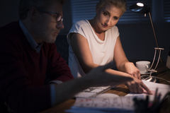 Working to late. Hard work until late hours royalty free stock image