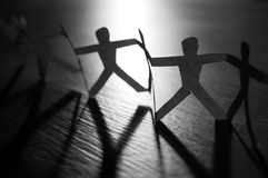 Working together. Conceptual photography with a chain of paper people stock photo