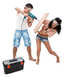 Working together. Happy young couple working with a drilling machine Stock Photography