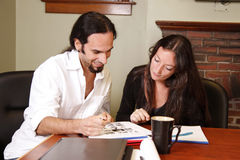 Working together. Business associates work together on a project royalty free stock images