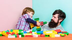 Working together. building plane with constructor. love. child development. happy family leisure. father and son play stock photos
