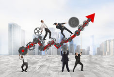 Working together for growth. Teamwork build an arrow upwards with gears mechanism Royalty Free Stock Photography