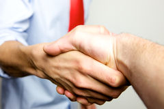 Working Together - Hand Shake with great spirit Stock Photos