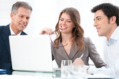 Working together at laptop Stock Photos