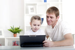 Working together for laptop Royalty Free Stock Photos