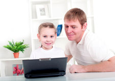 Working together for laptop Royalty Free Stock Images