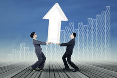 Working together for rising profit Stock Photo