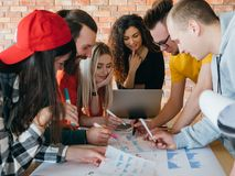 Working together business team diagrams strategy. Working together toward common goal. Successful business team analyzing diagrams. Strategy to increase sales royalty free stock image